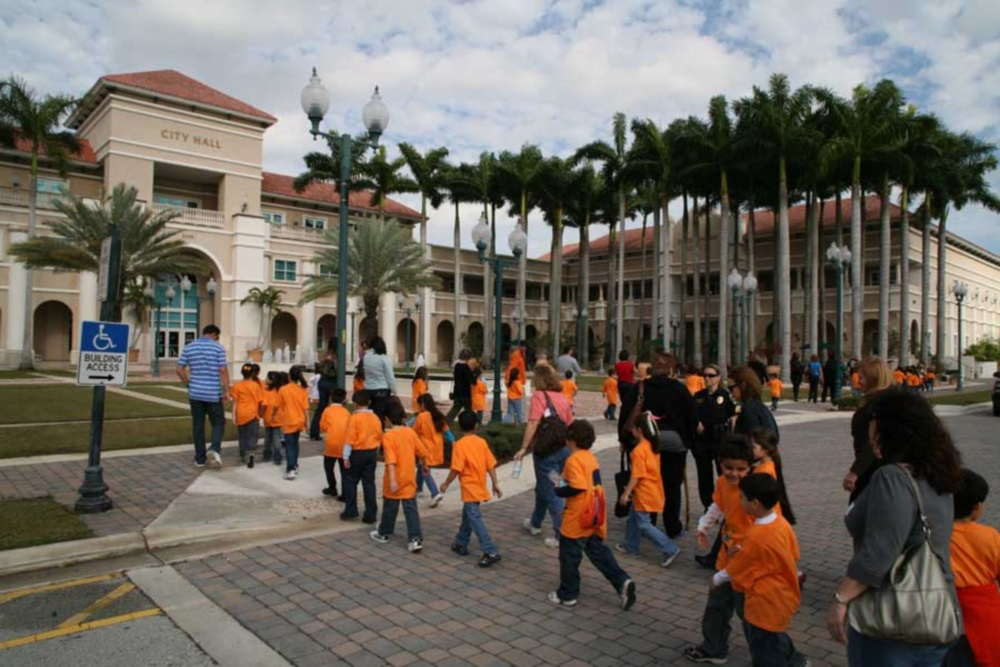 Students in orange shirts filing into the Cultural Center/ArtsPark